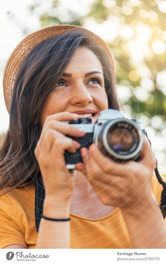 Smiling young woman using a camera to take photo. Photographer Woman Photography Camera Youth (Young adults) Girl Digital White Leisure and hobbies 1 Take