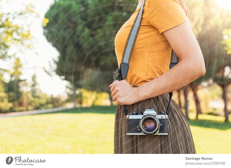 Close up of a photographer with her camera. Camera Photographer Professional Photography analogical Bag Easygoing casual dressing reflex caucasian ethnicity