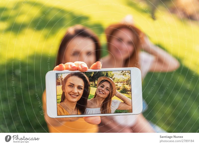 Beautiful women taking a selfie portrait in the park. Woman Picnic Friendship Youth (Young adults) Happy Summer Human being Joy Mobile PDA Telephone Solar cell