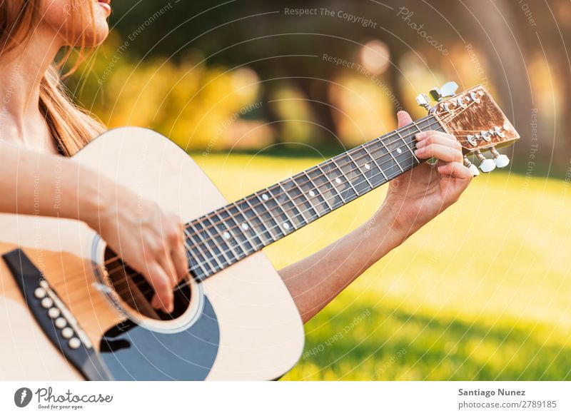 Beautiful woman playing guitar. Woman Picnic Youth (Young adults) Guitar Guitarist Park Happy Summer Human being Joy Playing Music Adults Girl pretty