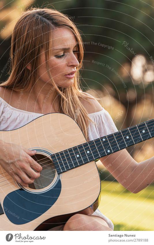 Beautiful woman playing guitar. Woman Picnic Youth (Young adults) Guitar Guitarist Park Happy Summer Human being Joy Playing Music Adults Girl pretty