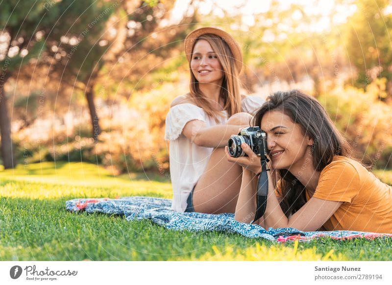 Beautiful women having fun taking any photography in the park. Woman Picnic Friendship Youth (Young adults) Park Happy Photographer session Photography Take
