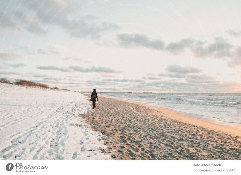 Woman walking on snow coast near sea Snow Coast Ocean Walking Lithuania klaipeda Sand Water Coat Hat Backpack Nature Winter Cold Frost White Lifestyle Lady Ice