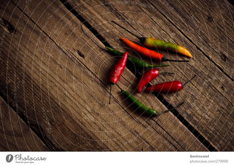 husks Fruit Herbs and spices Organic produce Vegetarian diet Slow food Fresh Healthy Multicoloured Tangy Chili Wooden table Food photograph Spicy Fiery