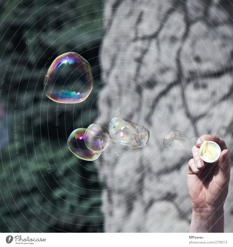 O oo o o o Human being Adults Hand 1 Crazy Soap bubble Toys Multicoloured Surface tension Fingers Playing Flying Colour photo Exterior shot