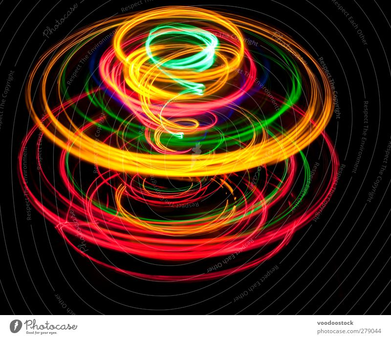 Spinning top of light Spiral Bright Yellow Green Red Black Colour circles trace colorful glowing eye catching Motion blur Rotation Rotate rotating