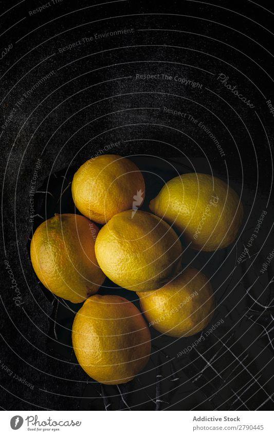 Fresh lemons on dark background. Lemon Food Fruit yellows vitamins Juice Detox Diet Organic Background picture Tropical Lemonade raw ingredient Lime Slice Dark
