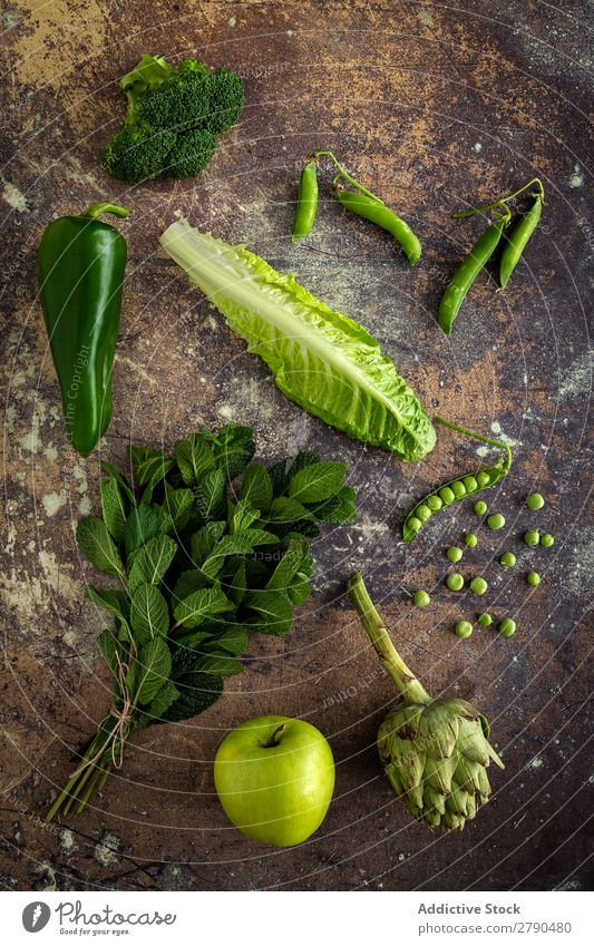Mix of fruits and vegetables in green color Vegetable Food Detox assortment Background picture Mint Lettuce Broccoli green peas Apple Artichoke Pepper Diet