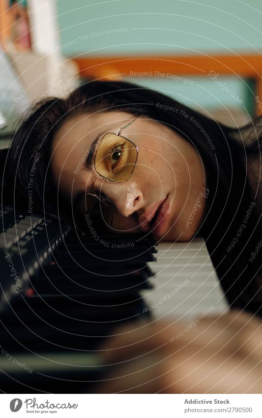 Young woman in sunglasses lying on piano Woman Piano Sunglasses Lie (Untruth) Youth (Young adults) Face Fatigue Attractive Head Key Lady Accessory Beautiful