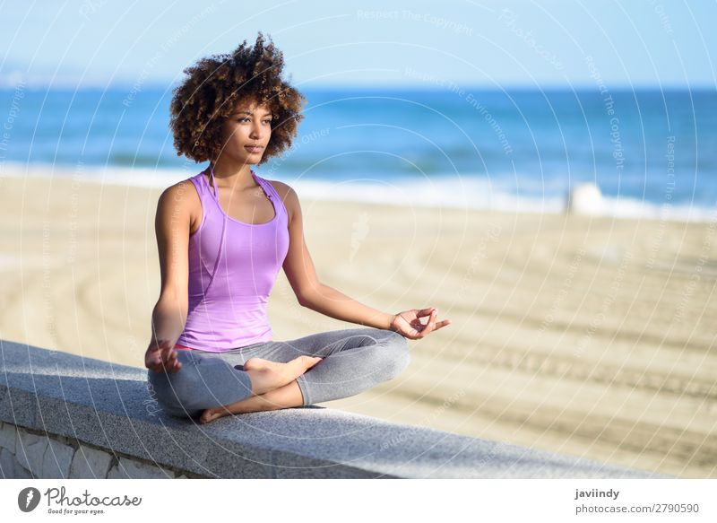 Black woman, afro hairstyle, doing yoga in the beach Lifestyle Beautiful Body Hair and hairstyles Wellness Relaxation Meditation Leisure and hobbies Beach Ocean