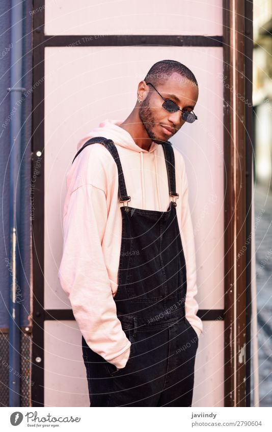 African guy with bib pants standing outdoors Lifestyle Beautiful Human being Masculine Young man Youth (Young adults) Man Adults 1 18 - 30 years Street Fashion