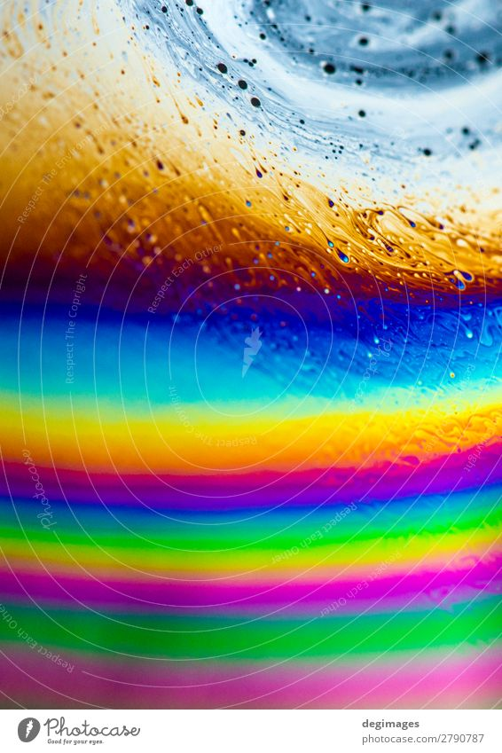 Colour spectrum abstract background. Rainbow colours. Art Bright Crazy Blue Consistency oil Soap bubble psychedelic iridescent light liquid water colorful