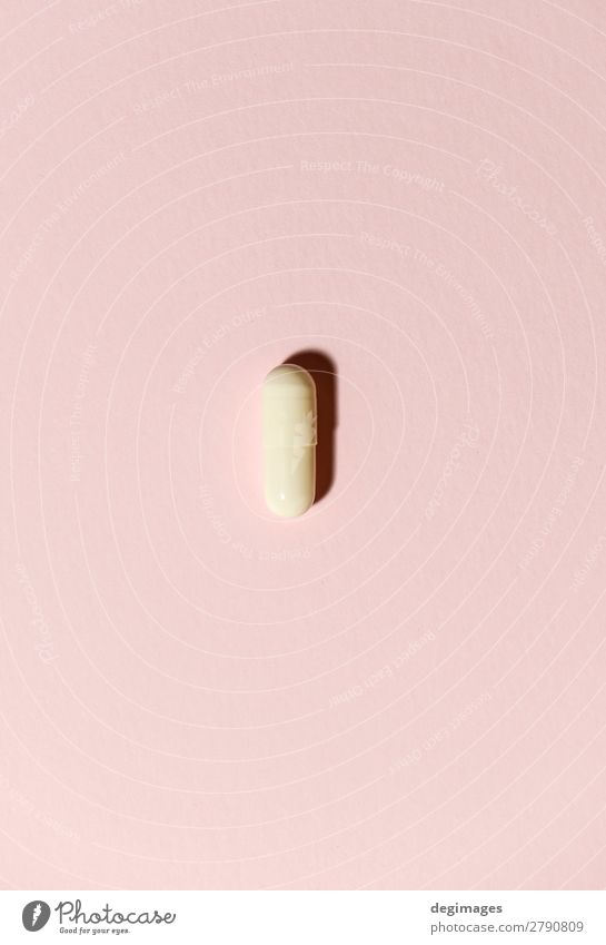 One white pill on orange background. Minimalist concep Health care Medical treatment Illness Medication Science & Research White Pain Pill medicine minimalist