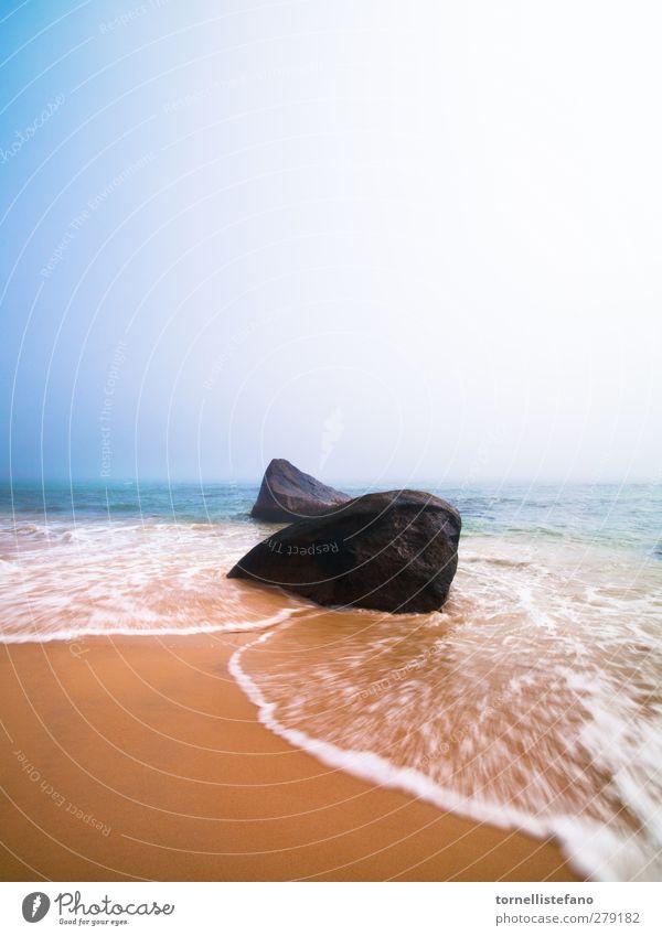 blurry waves Beautiful Ocean Beach Coast Sand Rock Waves Beautiful weather Blue sky Crash