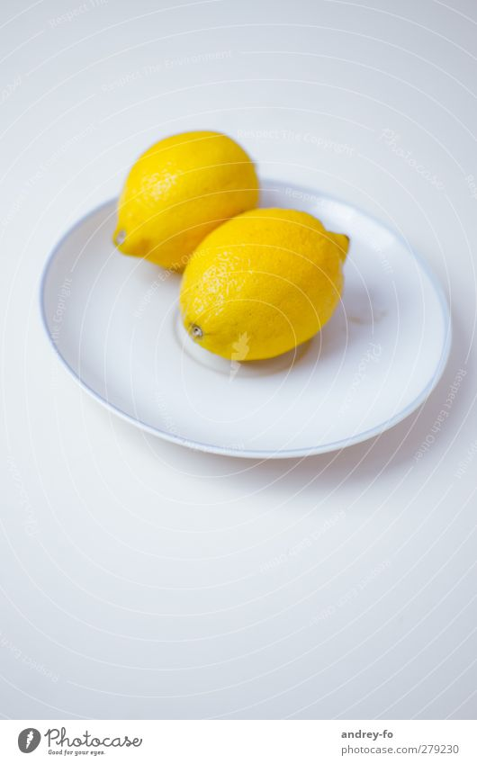 Two lemons. Life Sour Yellow Lemon Citrus fruits Plate Lie Food photograph Eating Minimalistic Delicious Fresh Organic produce 2 Edge of a plate Bright Round