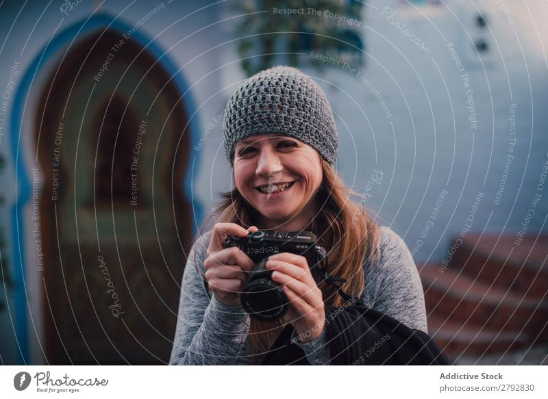 Laughing woman with camera Woman Street Morocco Laughter Photographer Professional Hat Chechaouen Tradition Vacation & Travel Culture City arabic Town