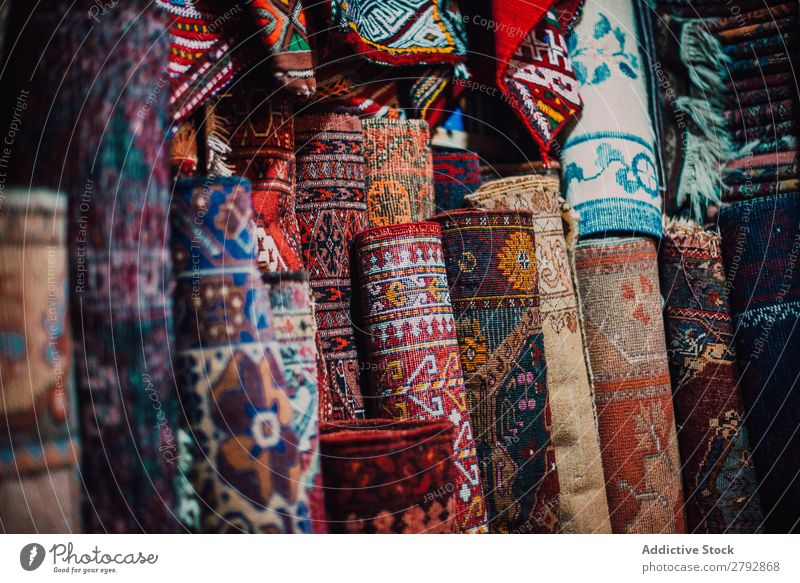 Store with colorful traditional carpets Markets Counter Carpet Exceptional Bright assortment Storage Shopping Pick choice East Bazaar Tradition Tourism