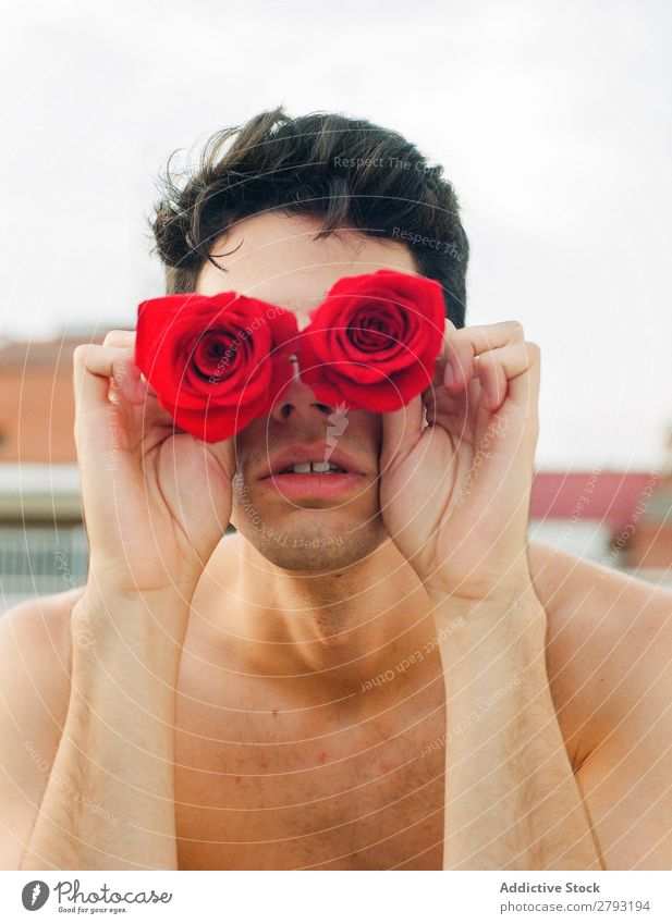 Young man with red flowers Man Flower Fresh Red Youth (Young adults) Rose Brunette Guy shirtless Surprise Gift Indicate romantic Aromatic Feasts & Celebrations