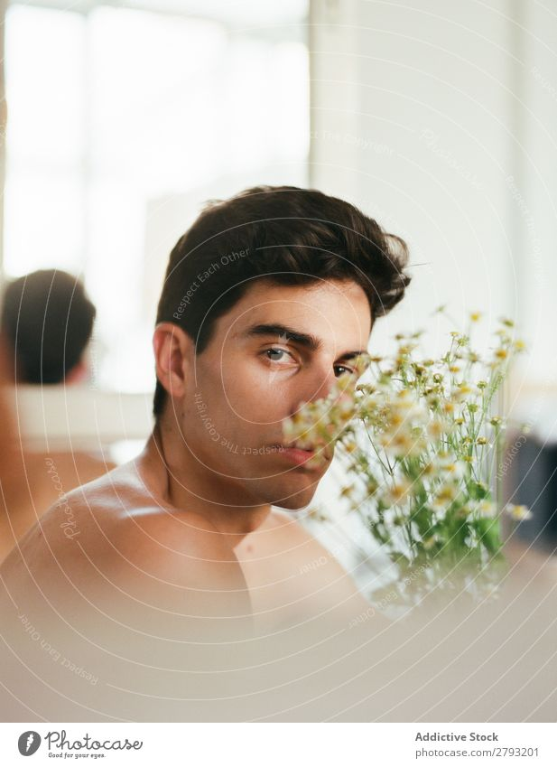 Young man with bunch of flowers in hands Man Mouth Flower Guy Fresh Youth (Young adults) Brunette White shirtless Surprise Gift romantic Daisy