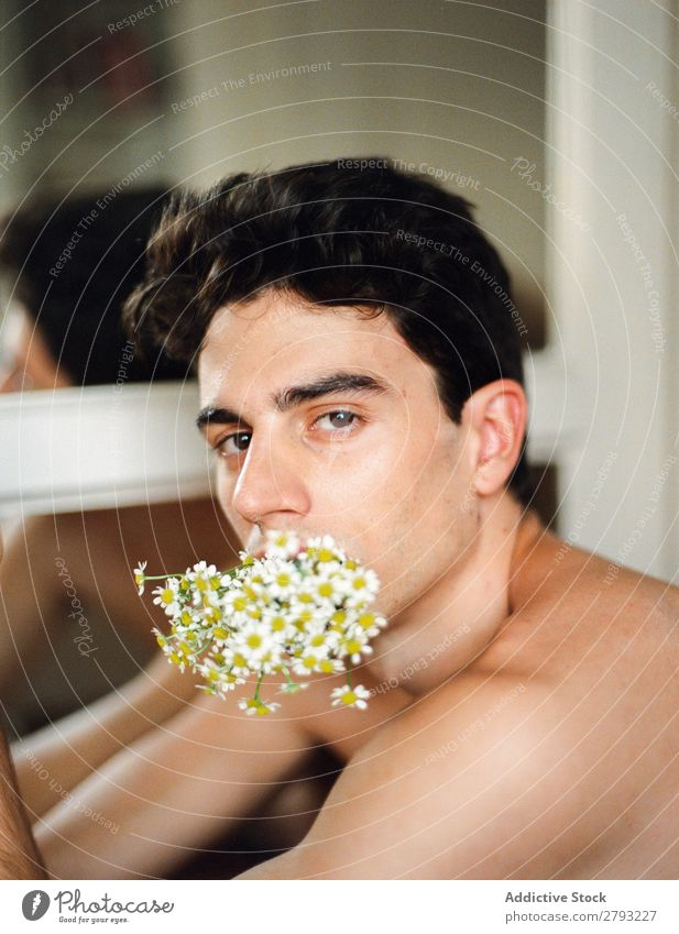 Young man with bunch of flowers in mouth Man Mouth Flower Guy Fresh Youth (Young adults) Brunette White shirtless Surprise Gift romantic Daisy