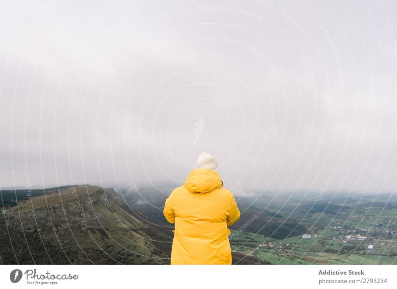 Man standing on top of hill Hill Top orduna Spain Hat Coat Yellow Mountain Sky Clouds Guy Adventure Vacation & Travel Peak Action Cliff Hiking Extreme Nature