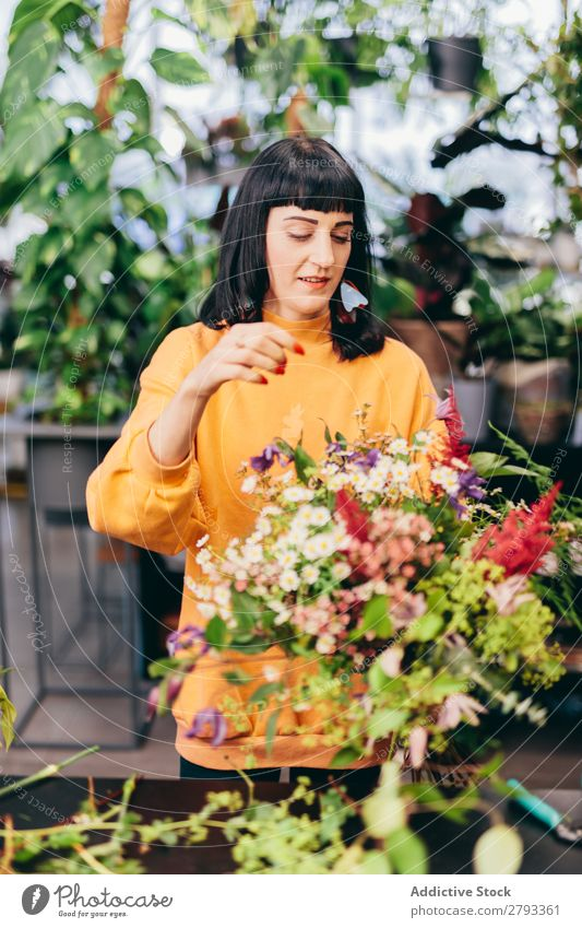 Woman putting together a flower bouquet. Florist Flower Shopping Happy Work and employment Hold Green Floral Girl Youth (Young adults) Bouquet Business Smiling