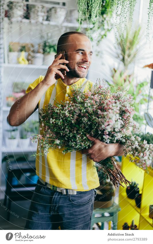 Man talking on the phone, holding flowers. To talk Business Flower Shopping Service Work and employment Happy Green Floral Bouquet Smiling Florist Retail sector