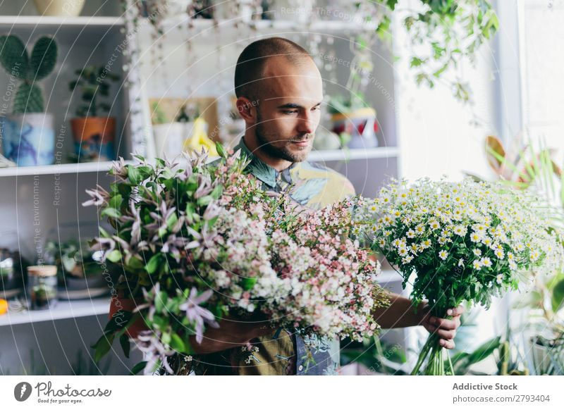 Man holding cut flowers in his hands. Flower Bouquet Hold Shopping Work and employment Happy Green Floral Guy Human being Youth (Young adults) Business Smiling