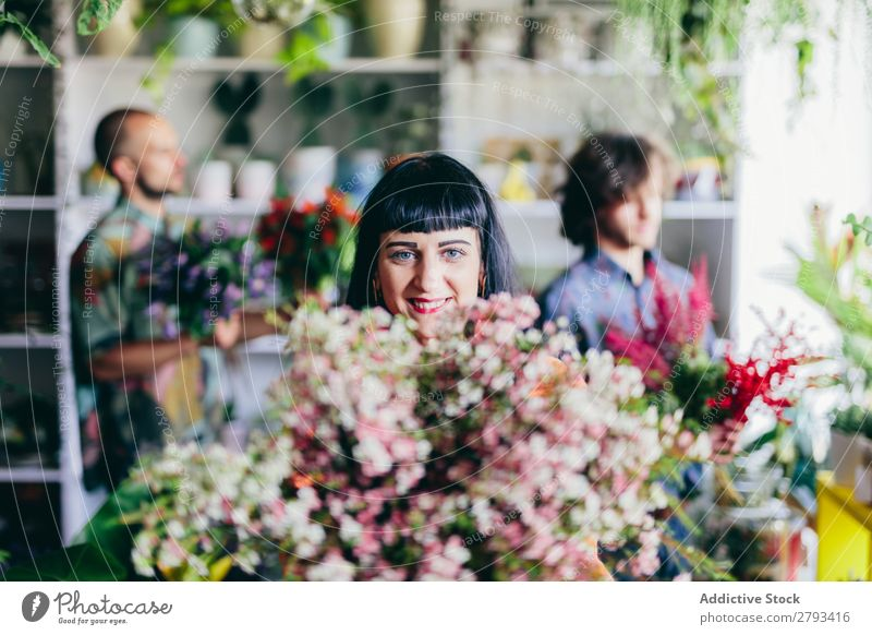 Portrait of woman and big bouquet of spring flowers Woman Flower Business Work and employment Hold Bouquet Shopping Man Happy Green Floral Guy Human being