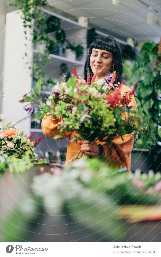 Woman making a colorful bouquet from flowers Florist Flower Shopping Happy Work and employment Hold Green Floral Girl Youth (Young adults) Bouquet Business