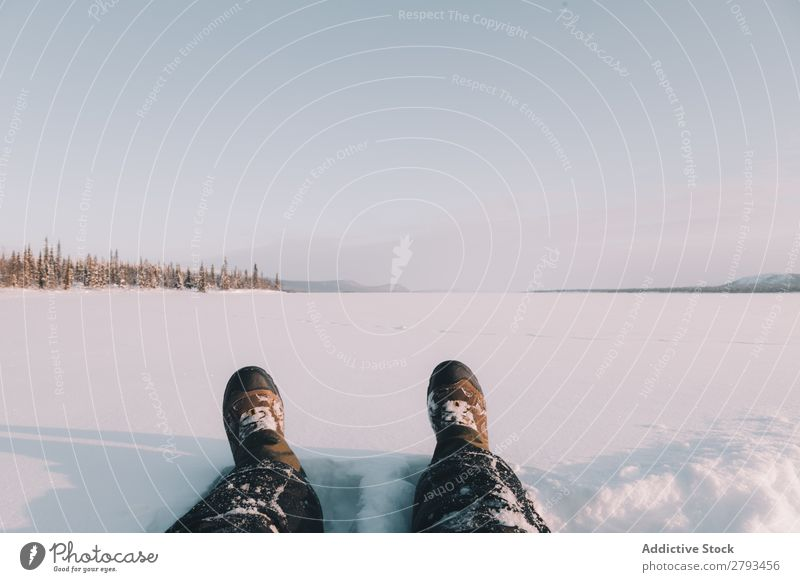 Crop legs in snowy field Legs traveler Snow Field Landscape The Arctic Winter Nature Seasons Cold Adventure Lifestyle Leisure and hobbies Rest Relaxation