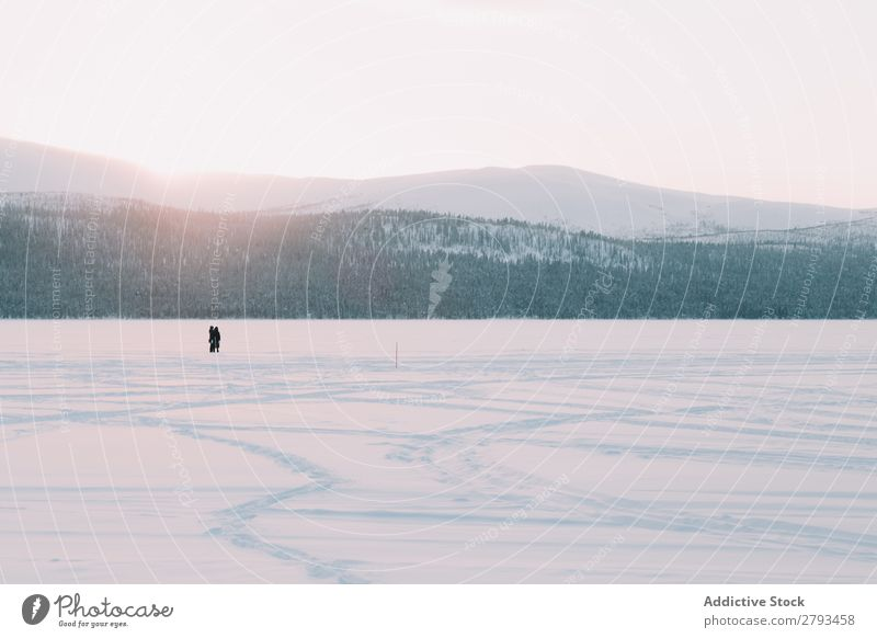 Anonymous people standing near river in snowy countryside Winter Landscape River Frozen Snow The Arctic Cold Vacation & Travel Stand Human being Cool (slang)