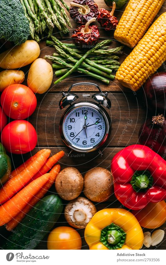 Vegetables lying around alarm clock Alarm clock Time Table Diet Conceptual design Food Healthy Nutrition Organic Vegan diet Set assorted Difference Mature Fresh