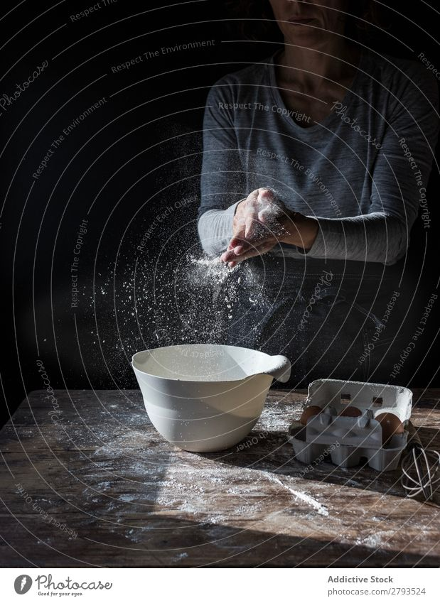 Woman clapping hands in flour near bowl and pack of eggs on table Hand Flour Bowl Egg Pack Table Applause Beater Wood Meal Craft (trade) Tasty Baked goods Lady