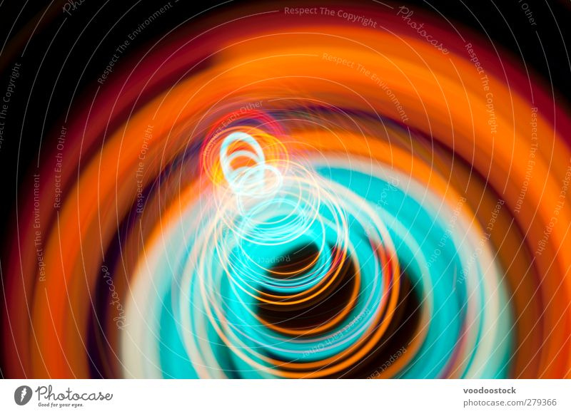 Abstract Coil of Spiral of Light Line Bright Colour circles trace colorful glowing eye catching Orange Cyan Glow Multicoloured Depth of field Studio shot