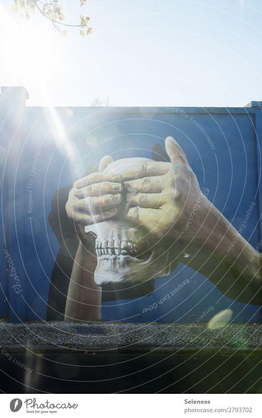 see nothing Graffiti Wall (building) Art Hand hands Death's head skull dead Sun Back-light Sunbeam out Exterior shot Facade Wall (barrier) Colour photo