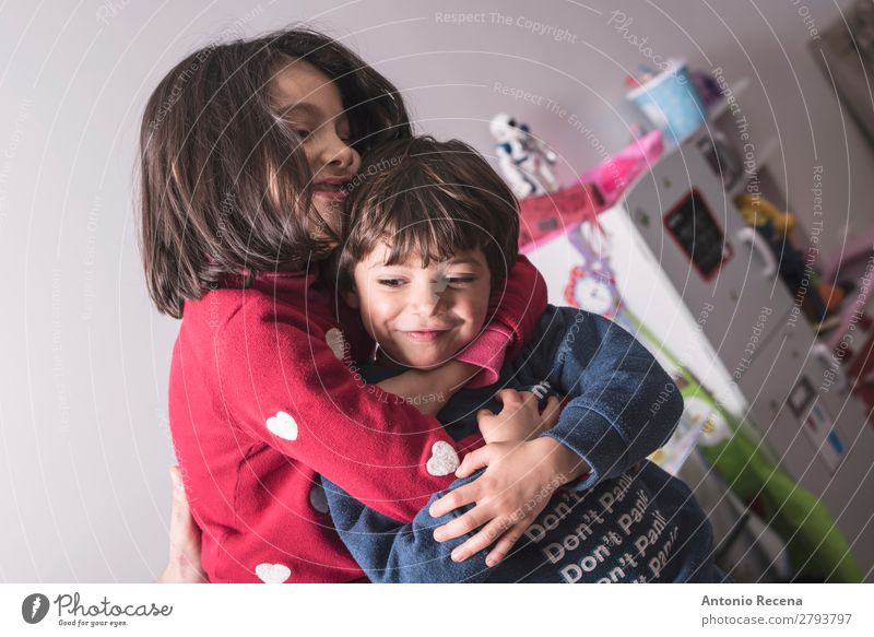 Brother and sister in great hug in lifestyle image Lifestyle Playing Kitchen Child Baby Toddler Boy (child) Sister Family & Relations Smiling Love Stand Cute