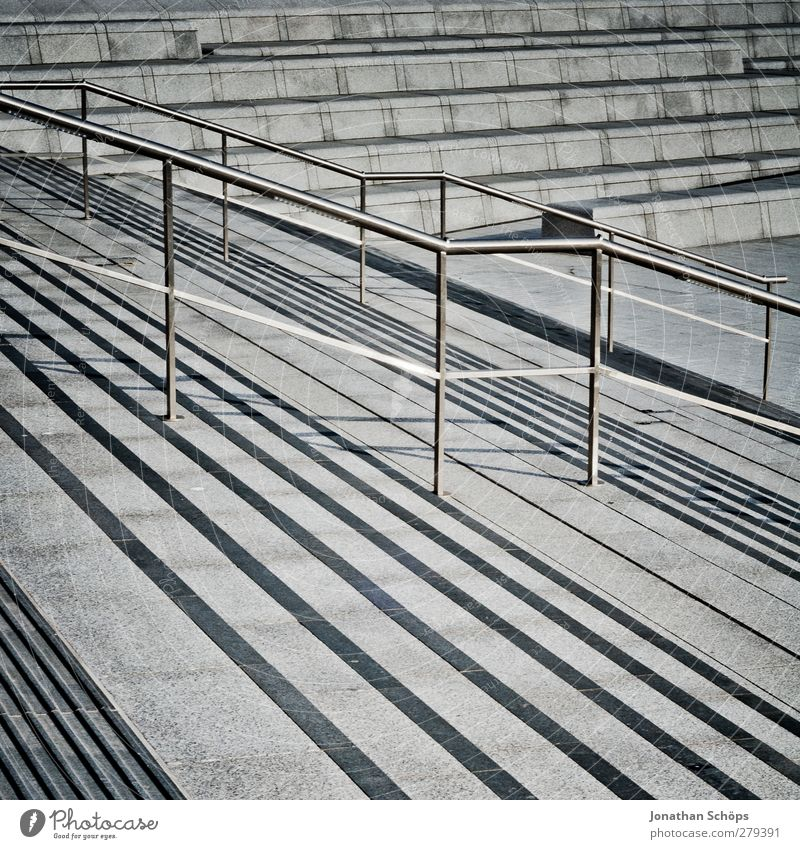 Staircase(s) Stairs Town Banister Handrail Gray Concrete Gloomy Descent Tilt Midday sun Line Geometry Structures and shapes Structural change Stripe Abstract