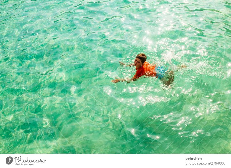 Child Vacation & Travel Ocean Relaxation Far-off places Beach Face Legs Coast Boy (child) Tourism Playing Exceptional Freedom Hair and hairstyles Head