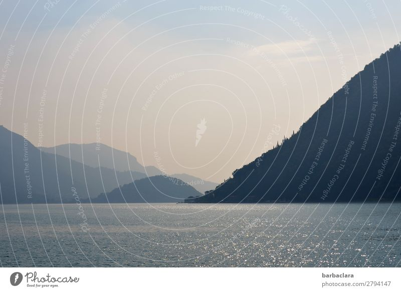 Water, mountains, blue sky at Lake Iseo. Vacation & Travel Far-off places Landscape Elements Earth Sky Alps Mountain Italy Village Fishing village To enjoy Blue