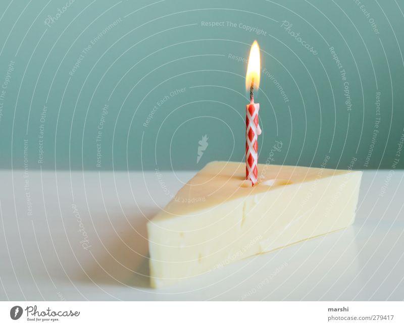 a piece of cheesecake Food Cheese Dessert Nutrition Eating Yellow cheese cake piece of cake Cake Candle Candlelight Birthday Birthday cake Birthday wish Burn