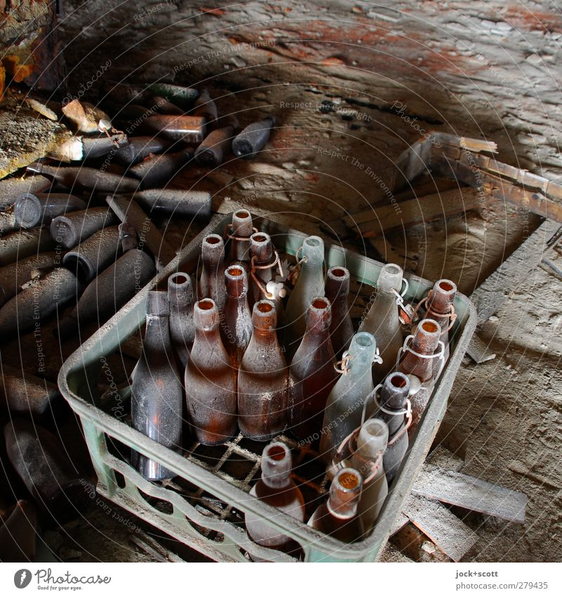 Beer's long gone Ground Box Bottle Case of beer Dirty Cheap Broken Brown Apocalyptic sentiment Nostalgia Past Transience Change Dusty Empty Remainder