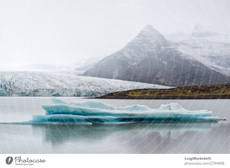 Iceberg in Fjallsarlon glacier lagoon, Iceland Sky Vacation & Travel Nature Blue Colour Water White Landscape Winter Mountain Snow Lake Fog Island Hill Frost