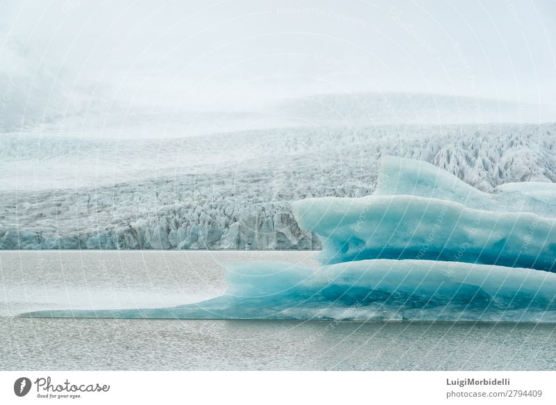 Closeup of iceberg in Fjallsarlon glacier lagoon, Iceland Vacation & Travel Island Winter Snow Mountain Nature Landscape Water Sky Fog Frost Hill Glacier Lake