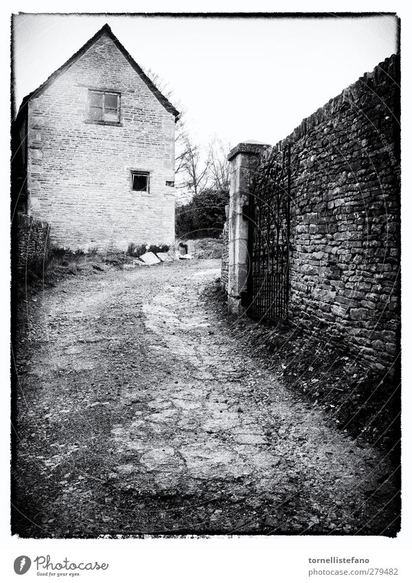gated entranceway in england Architecture Black & white photo cotswolds country Landscape Driveway England Europe Fence Home House (Residential Structure)