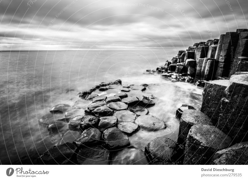 Place of relaxation Vacation & Travel Sightseeing Ocean Waves Landscape Sky Clouds Weather Rock Coast Black White Northern Ireland Giant´s Causeway Stone Water