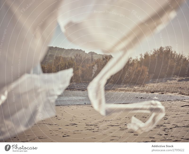 Girl entangled in waving textile on river coast River Coast Child Hand Side Wind Conceptual design Sand Landscape Beach Help White Water Sun Joy Happiness