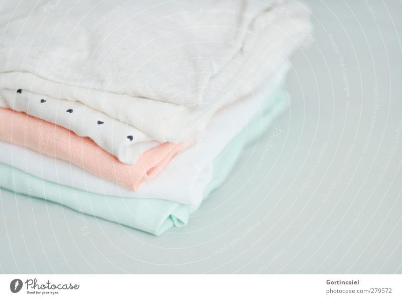 textile Fashion Clothing T-shirt Shirt Bright Clean Pastel tone Blouse Orange Mint green Laundered Laundry Stack Textiles Cotton Silk Soft Colour photo