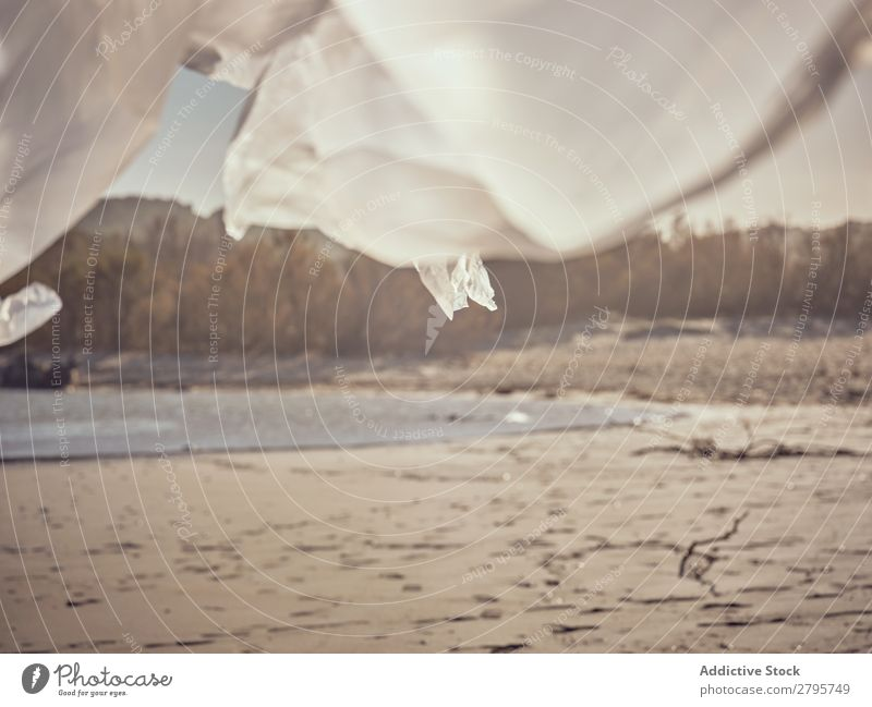 Textile and sand coast near water textile Coast Water Sand waving River Wind Bushes Sunbeam Day Conceptual design Landscape Summer Beach White Plant Natural