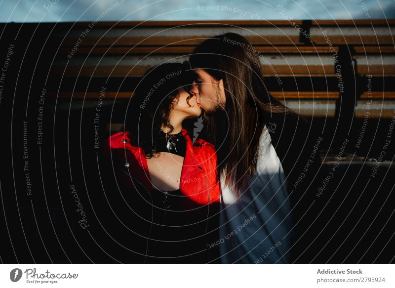 Long haired man hugging and kissing woman near train Couple abandoned wagons Embrace Railroad Graffiti old train Kissing Love Engines Hipster